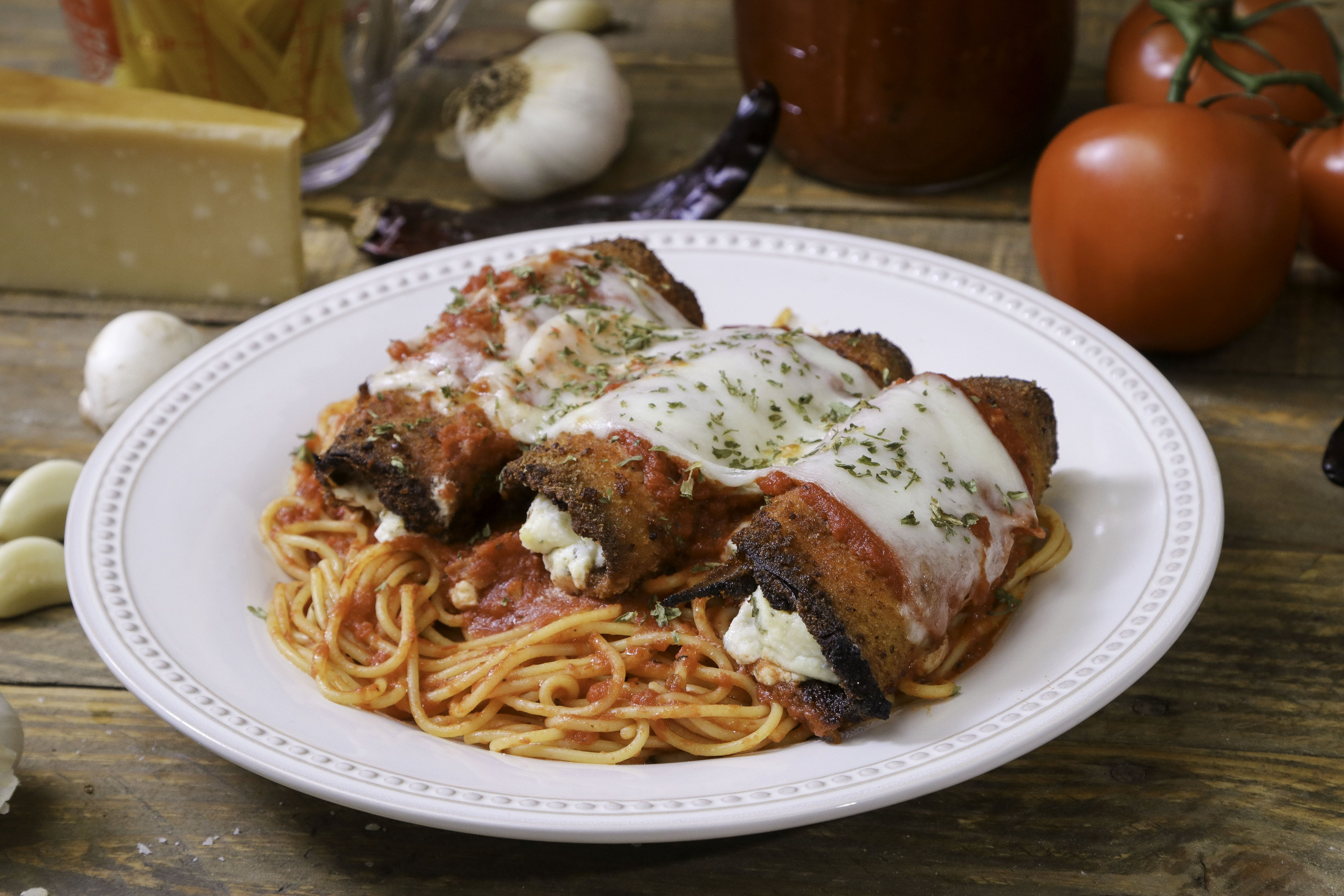Breaded Eggplant Parmigiana with Spaghetti from Ameci Pizza & Pasta - Lake Forest in Lake Forest, CA