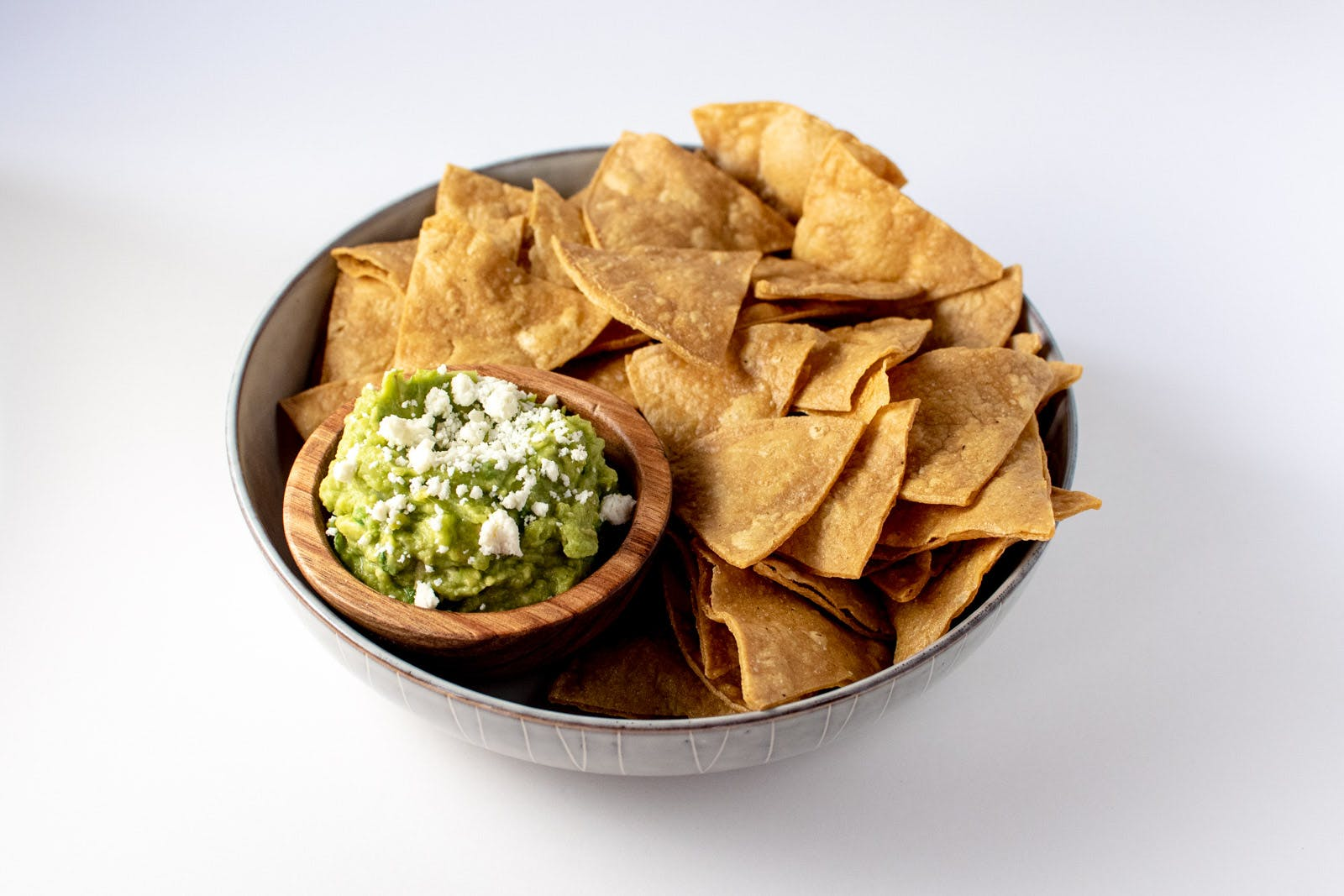 Yellow Corn Tortilla Chips and Guacamole from Taco Royale - Eastside Madison in Madison, WI