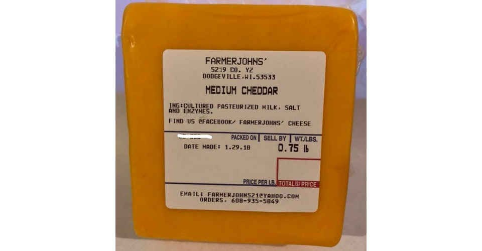 Medium Cheddar Cheese from Vitruvian Farms in Madison, WI
