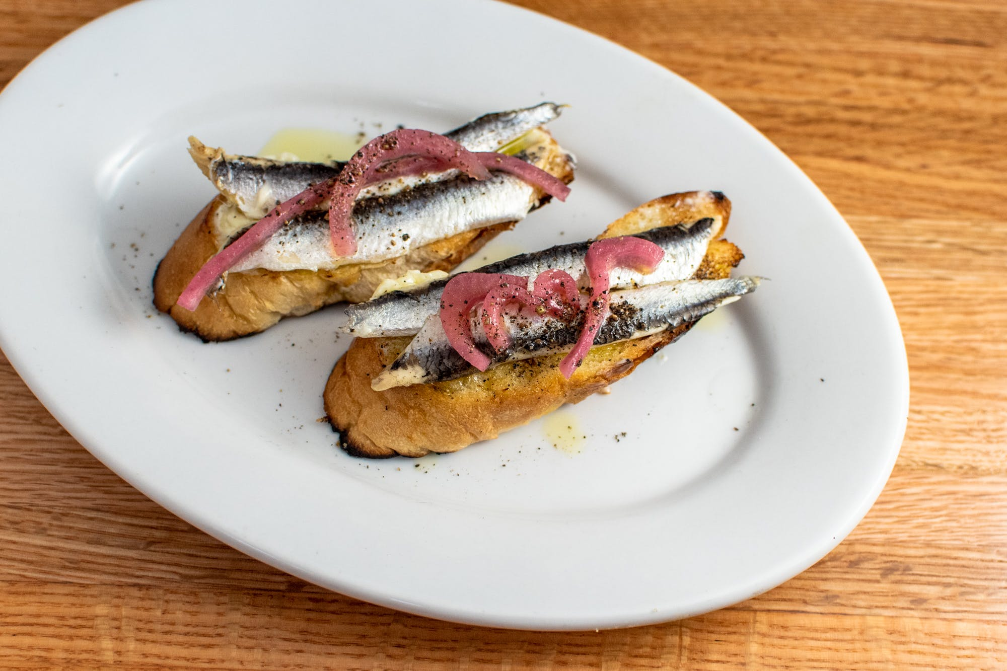 Crostini White Anchovy from 107 State in Madison, WI