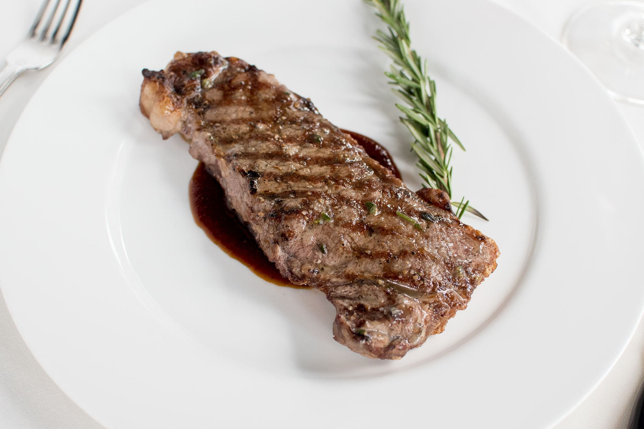 12 oz New York Strip from Johnny Delmonico's Steakhouse in Madison, WI