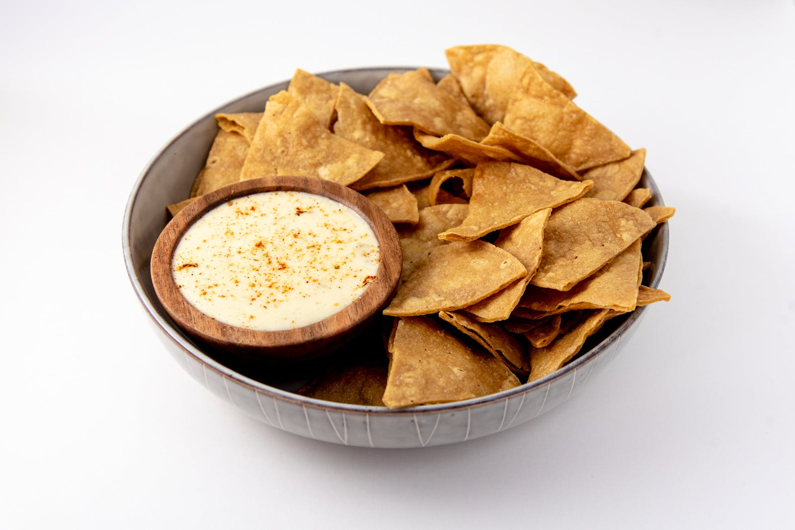 Yellow Corn Tortilla Chips and White Cheddar-Green Chili Queso from Taco Royale - Eastside Madison in Madison, WI