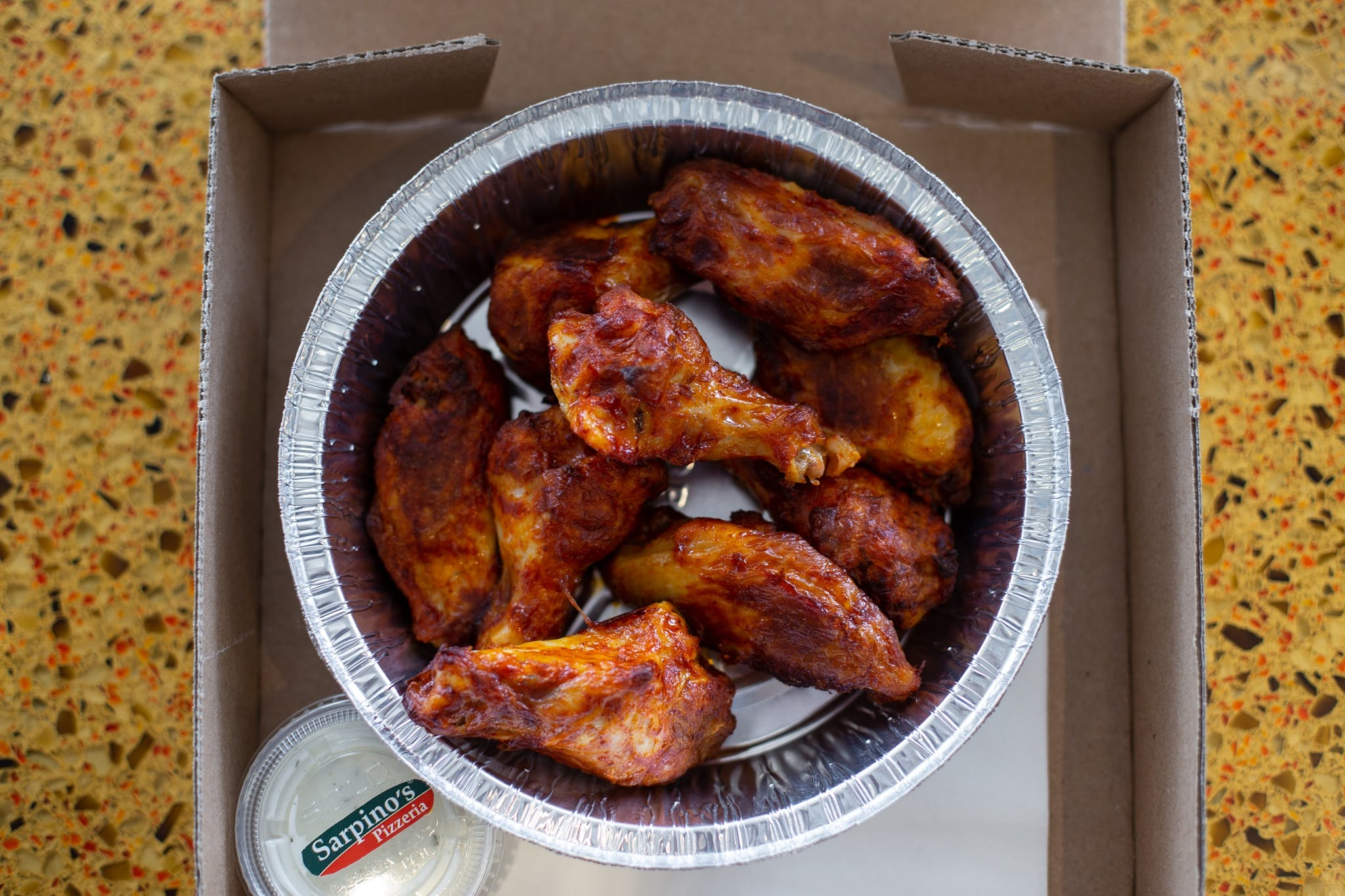 Hot'n Spicy Buffalo Chicken Wings - 1 lb. from Sarpino's Pizzeria - Washington Ave. in Minneapolis, MN
