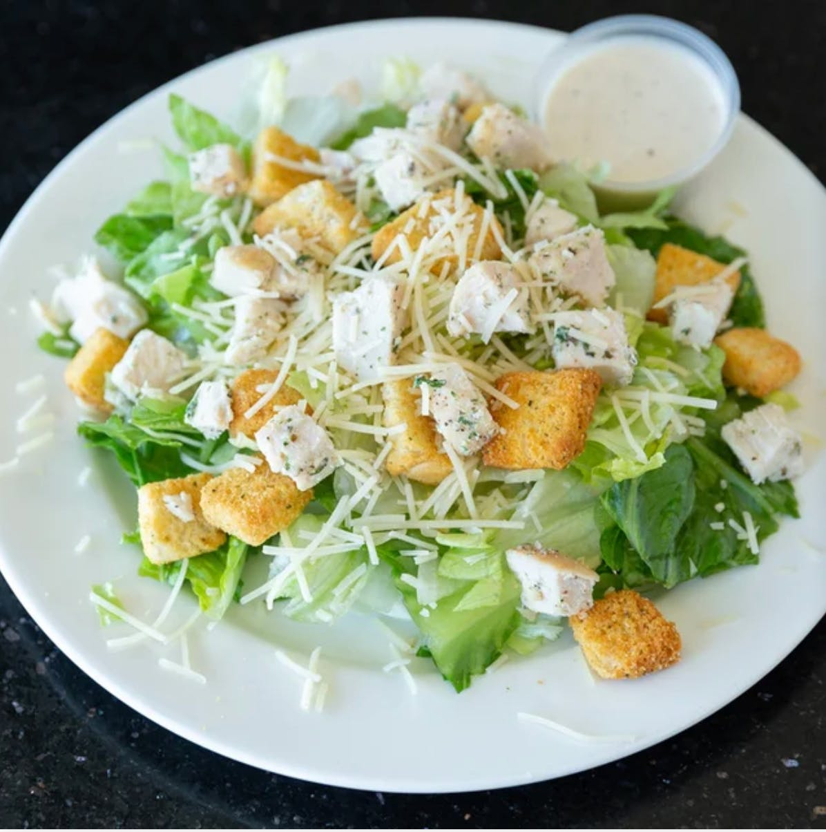 Chicken Caesar Salad from Aroma Pizza & Pasta in Lake Forest, CA