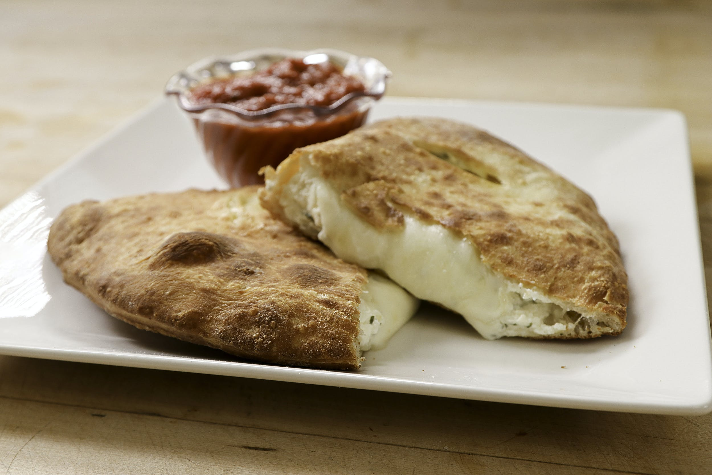 Cheese Calzone from Ameci Pizza & Pasta - Lake Forest in Lake Forest, CA